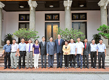 The delegation from Canada meeting with members of the Hai Duong province legislature in fall 2012 at a special meeting to discuss the hospital project considered for at Di An Industrial zone in Hai Duong province. Pictured beside Marc Kealey (centre) to the right are Madame Phuong, Chair of Dai An JSC and partner to Triple Eye Corp